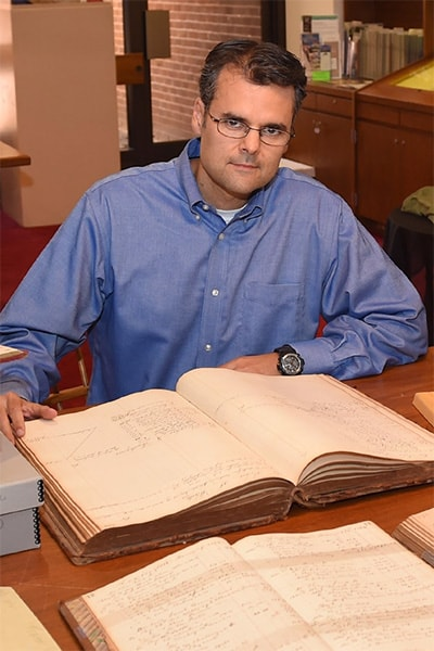 Stephan Fafatas pores over old canal company accounting ledgers in W&L Special Collections.
