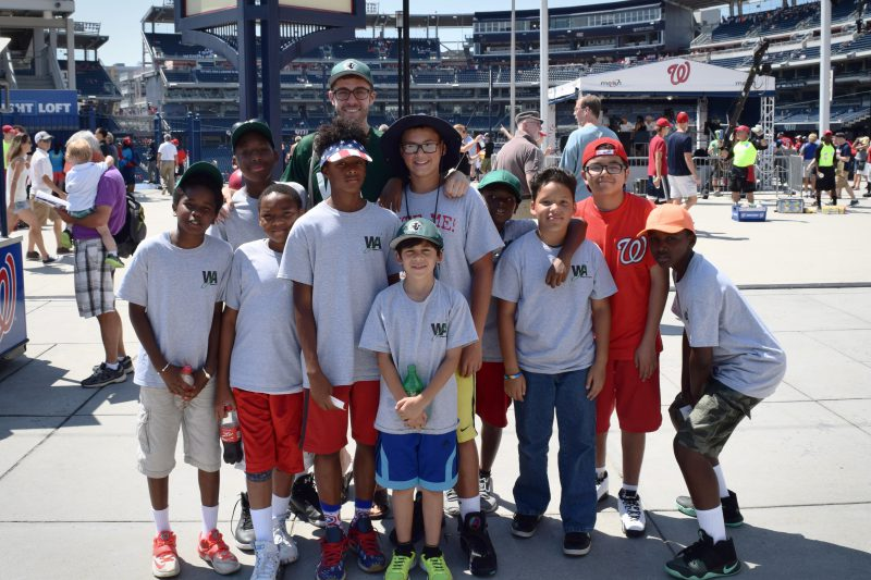 Zach Taylor '17 with students from the Washington Jesuit Academy at a D.C. Nationals game.