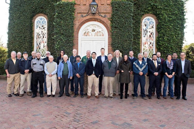 Washington and Lee University solutes its veterans. Front row, l. to r: Bob Shaeffer, Ted Hickman, Daniel R. Rexrode, Buddy Atkins, John DeVogt, Dale Lyle, Nicolas Ramos, Al Carr, Grimes Waybright, Mark Fontenot, Devin White, Annie Cox Tripp, Paul Youngman. Back row, l. to r.: Tom Tinsley, Len Reiss, Laurie Lipscomb, Gabrielle Ongies, Jerry Clark, Mike Young, Andrew Smeltzer, Timothy Keefer, J. David Thompson, William Carpenter, Michael Stinnett-Kassoff, David Garcia.