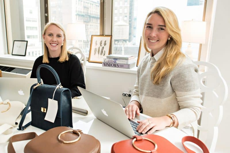 Chloe Burch '14 and Neely Burch '13 working on their handbag and shoe  business in their New York City apartment.