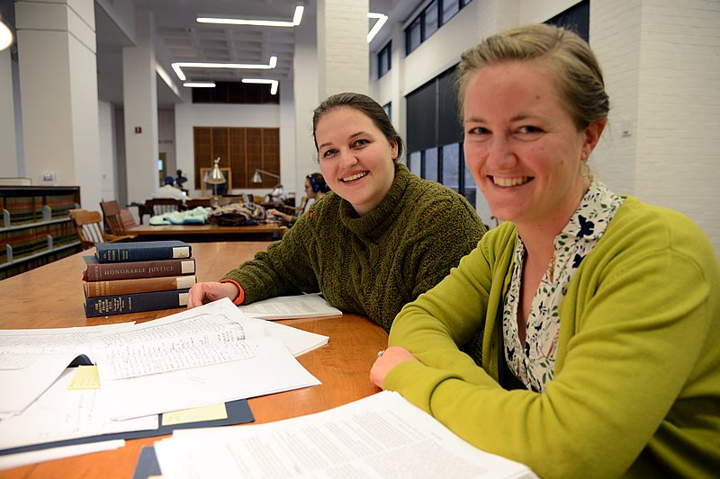 Jess Winn, right, and Lizzy Williams with Belknap's diary and othe research materials.