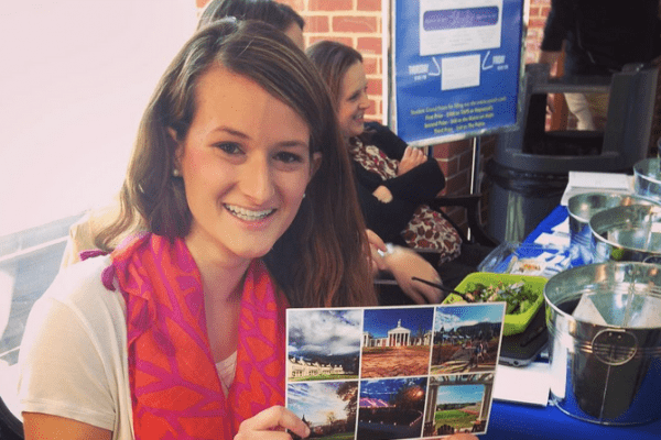Julia Gsell '18 holds up a post card she has written to a donor.