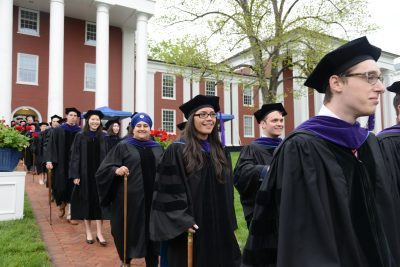 Law students make their way to their seats.