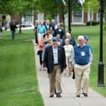 Alumni back on campus for Alumni Weekend 2016 walk across the lawn toward Lee Chapel.