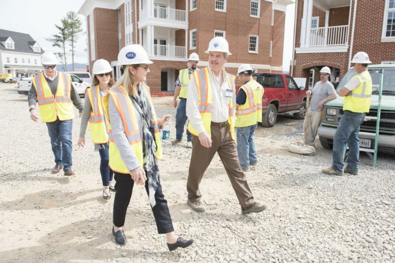 PLC members receiving a hard hat tour of W&L's new upper division housing.