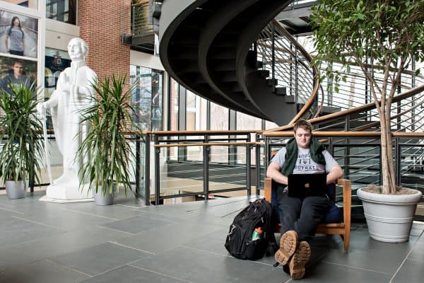 YIR03-600x400 A student sits in the common's atrium.