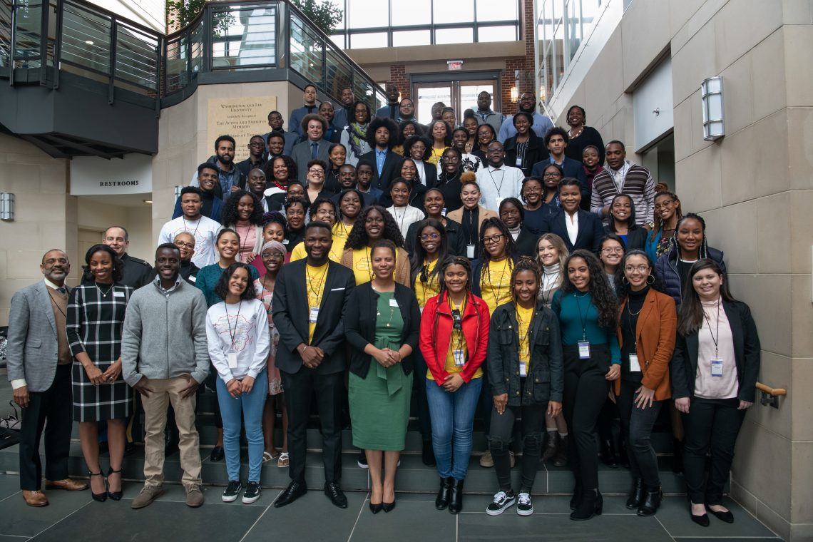 Attendees and speakers at the Black FLEX Conference pose for a photo in Elrod Commons.