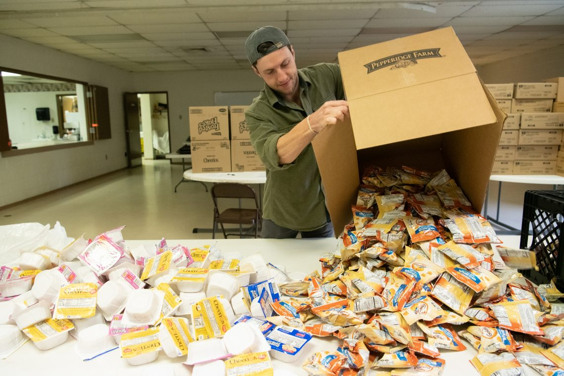 Campus Kitchen Coordinator Ryan Brink prepares to make snack packs for the Backpack Program.
