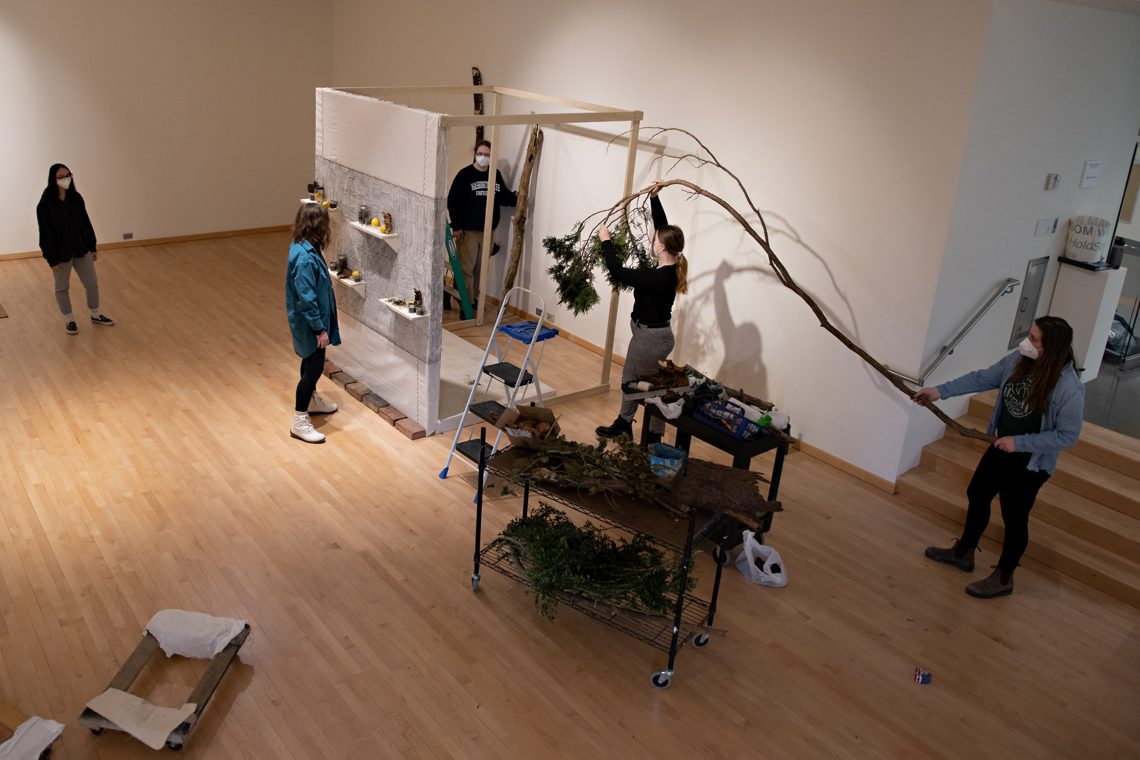 Students install work in the Staniar Gallery