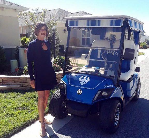 Roberts-and-golf-cart-scaled-576x533 Nurturing the NASDAQ