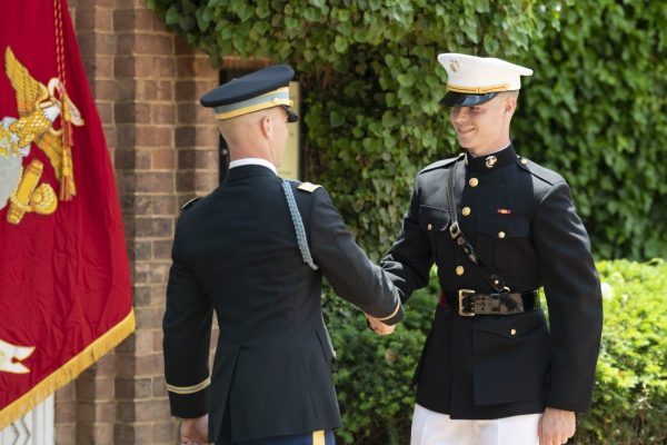 Woodings-commissioning_Post-Oath-of-Office-Handshake-with-brother-scaled-600x400 A Commitment to Service